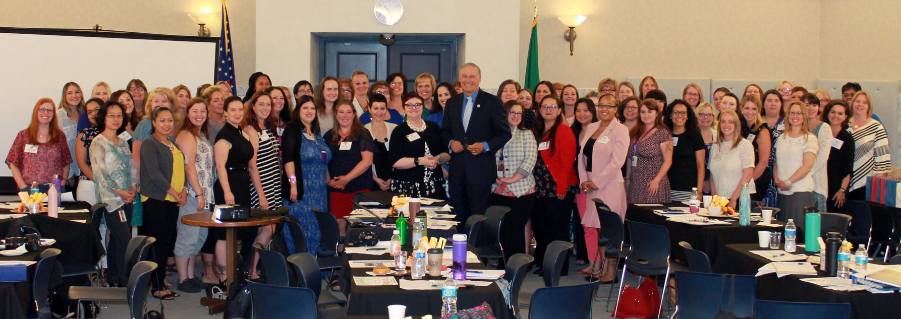 Governor Jay Inslee (center) poses with ICSEW representatives at the 2018 Transition Celebration in Olympia.