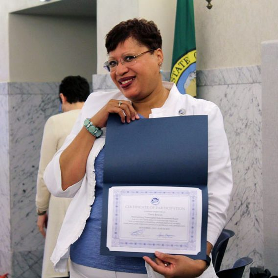 woman holding certificate of participation